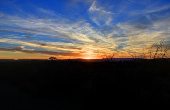 dark sunset over the desert at big bend national park texas