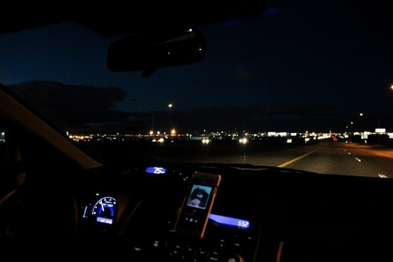dashboard of car driving at night