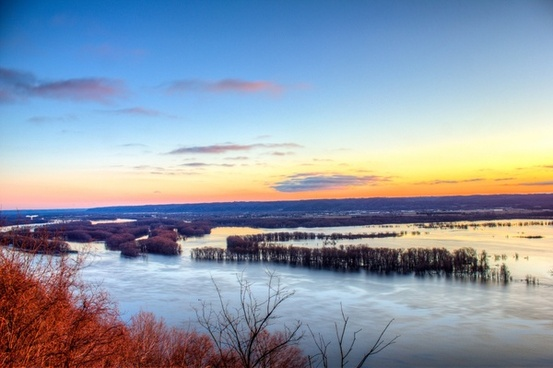 dawn on the landscape of the mississippi river at pikes peak state park iowa