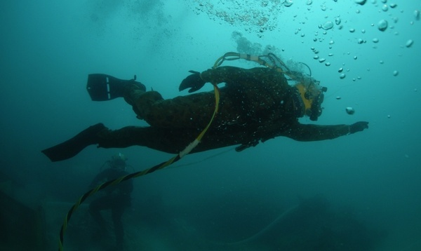 diver swimming underwater