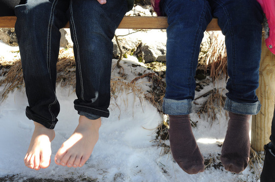 drying feet on a sunny winter day in bavaria