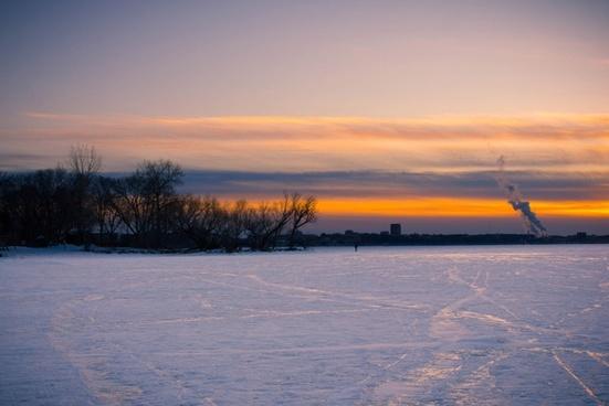 dusk over the frozen lake landscape on lake mendota madison wisconsin