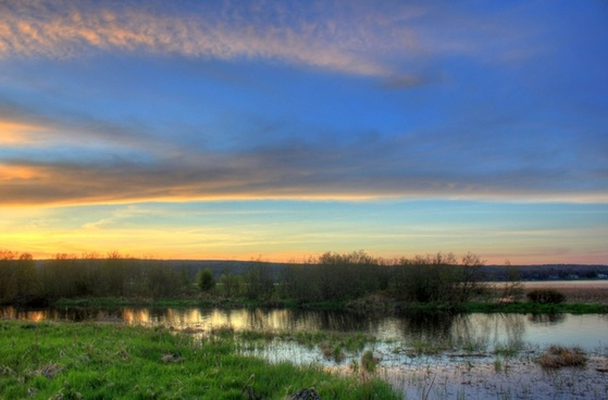 dusk skies over marshy landscape in the upper peninsula michigan