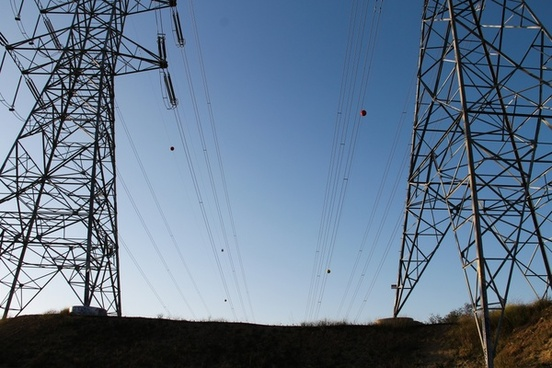 electric poles with wires on clear blue sky