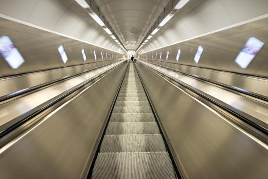 empty shiny steep escalator indoor