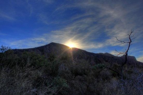 fading sun behind the hills at big bend national park texas