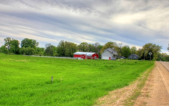 farmhouse and barn in the landscape in southern wisconsin