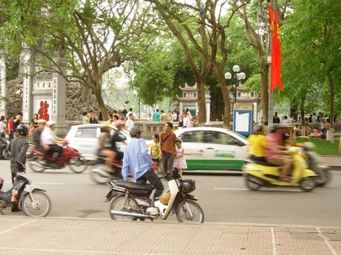 father and daughters in hanoi street