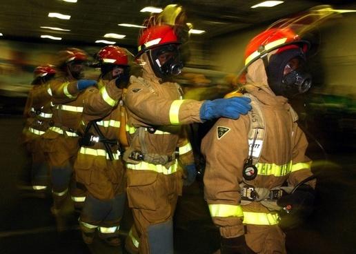 firemen drill firefighters