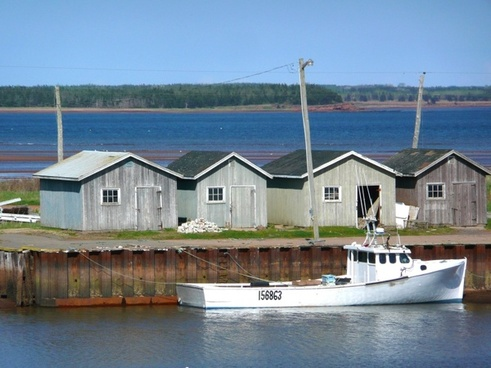 fisher huts boats water