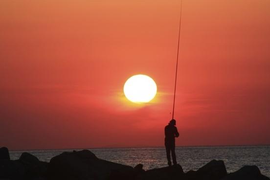 fisherman sunset greece