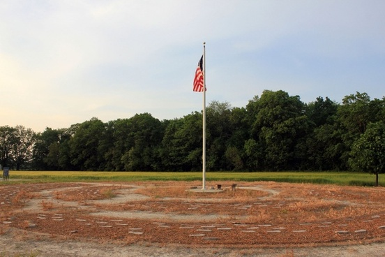 flag at center of the square at prophetstown state park indiana