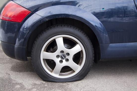 flatfoot senselessly mature flat tire
