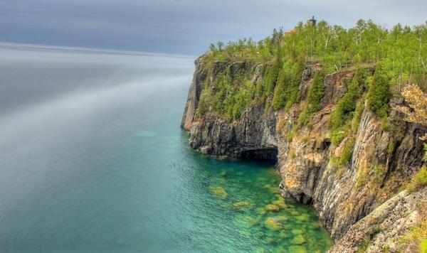 foggy shores at split rock lighthouse minnesota