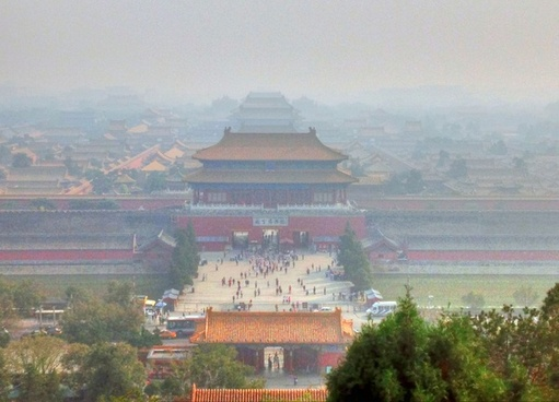 forbidden city under smog in beijing china