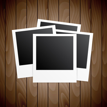 four blanks photo frames on wooden