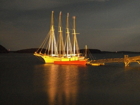 four masted schooner in moonlight