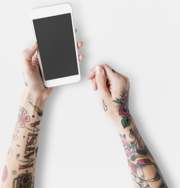 free hand with tattoos using mobile phone mockup