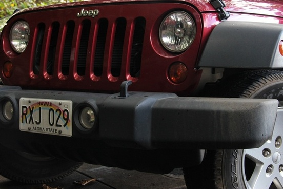 front grill of red jeep
