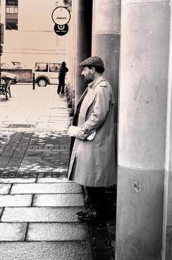 gentleman with newspapers