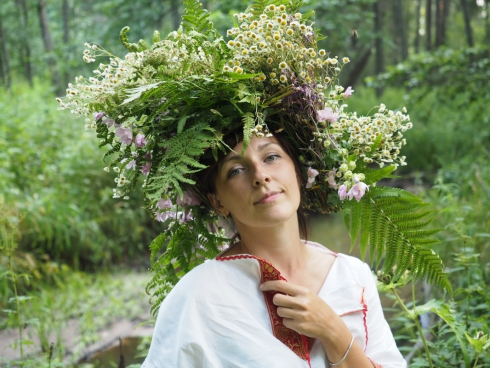 beautiful woman with stylish flowers hat