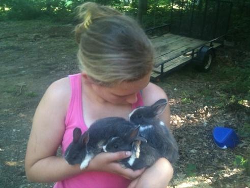 girl holding bunnies