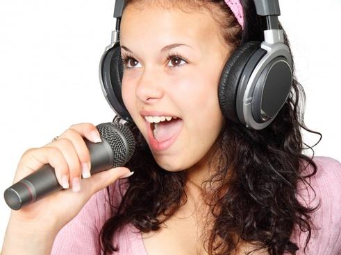 girl holding karaoke
