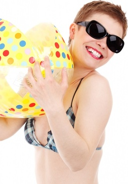 girl in swimsuit with beach ball