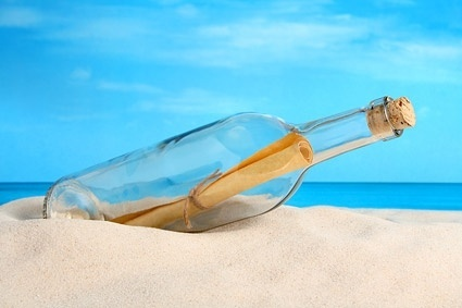 glass bottles on the beach picture 2