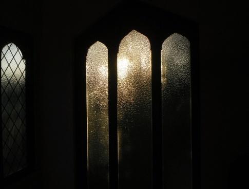glass window with sun set