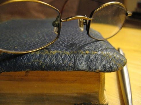 glasses on old book