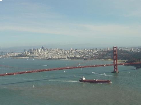 golden gate bridge with cargo ship