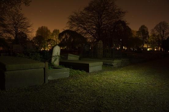 gravestones at night