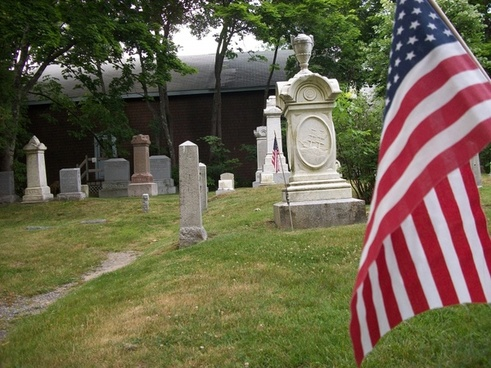 gravestones with flag