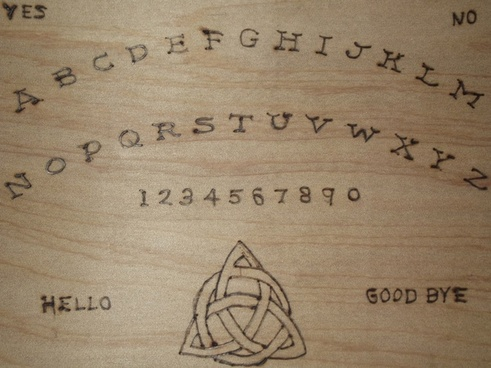 hand made ouija board close up