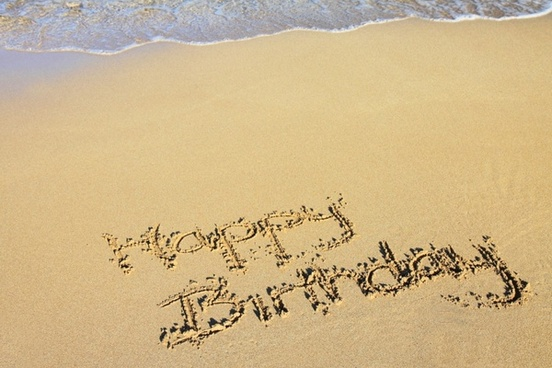 happy birthday in sand