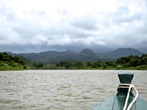 head of canoe on river towards mountains