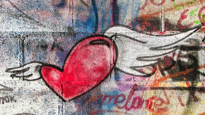 heart wing painting on grunge wall