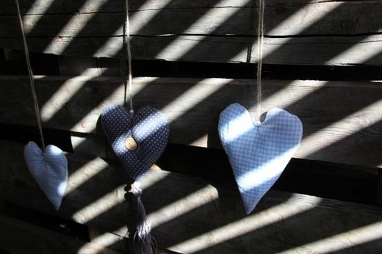 heart wooden wall shadow play