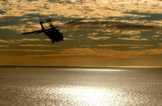 helicopter aircraft sunset