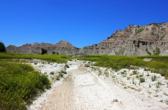 hiking path into the hills at badlands national park south dakota