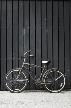 hipster bicycle parked aganst a wall