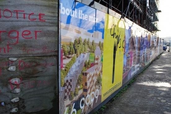 hoarding around a derelict building