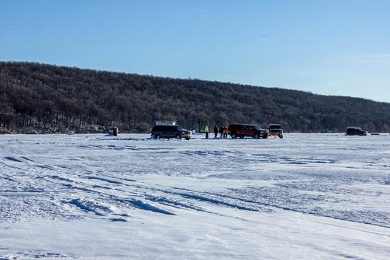 ice fishing scene on lake winnebago at high cliff state park wisconsin