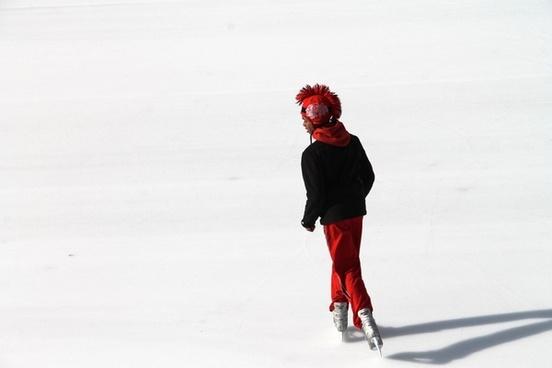 ice skater in black 038 red on ice skating rink