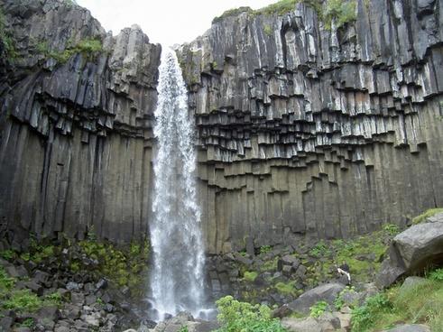 iceland waterfall rock