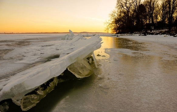 icy landscape over the lake at governor nelson state park wisconsin