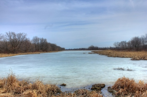 icy pond on the great river trail wisconsin