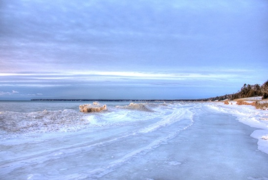 icy shore at whitefish dunes state park wisconsin