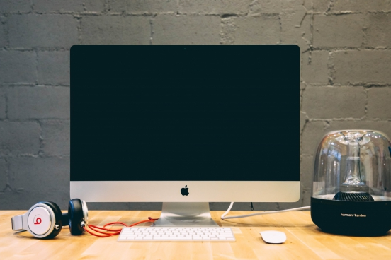imac with white wireless mouse and keyboard